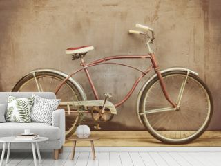 Vintage rusted cruiser bicycle on a wooden floor