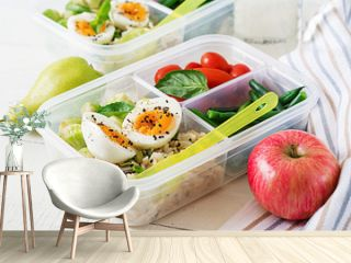 Vegetarian meal prep containers with eggs, brussel sprouts, green beans and tomato. Dinner in lunch box