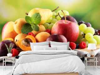 Fresh summer fruits with apple, grapes, berries, pear and apricot