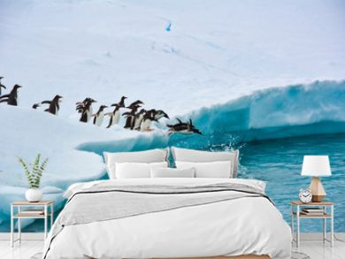 Penguins One After Another Funny Jump Into The Blue Water From A Snow-white Iceberg, Antarctica