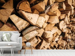 Wooden firewood stacked in a wall