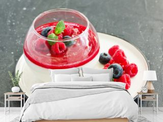 Delicious Italian dessert panna cotta with berries and berry sauce. Valentine's Day.