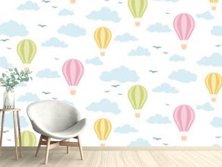 Seamless pattern balloons in the clouds, light shades.