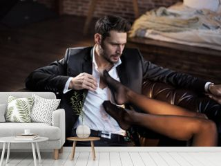 Handsome businessman relaxing in the luxurious apartment with a sensual woman