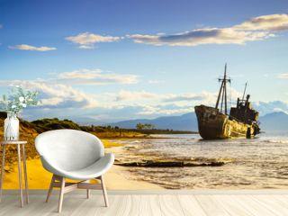 Rusty broken shipwreck on sea shore