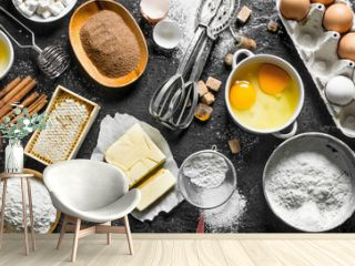 Baking background. Flour and various ingredients for dough.