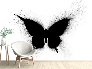 Black silhouette of a butterfly with paint splashes and blots, isolated on a white background.