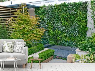 A small urban environmental Eco garden with a vertical living plant wall