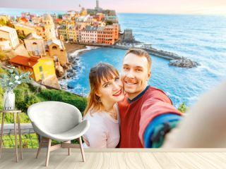 Tourists happy couple taking selfie photo of Vernazza, national park Cinque Terre, Liguria, Italy, Europe. Concept travel