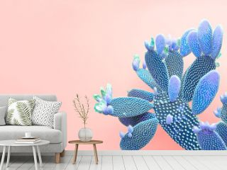 Trendy tropical Green Neon Cactus on coral Color background. Fashion Minimal Art Concept. Creative Style. Cacti colorfull fashionable mood