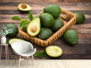 Fresh organic avocado on the wooden table