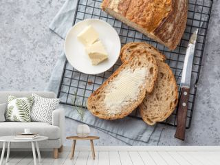 slices of freshly baked homemade sour dough bread with butter
