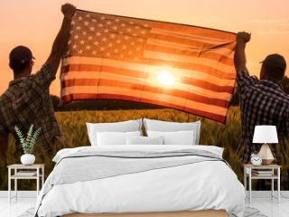 Two men energetically raised the US flag in a picturesque field of wheat
