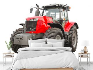 Big red agricultural tractor isolated on a white background