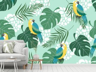Hand drawn seamless pattern with tropical birds and leaves on blue background. Vector flat illustration of parrots .