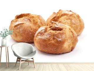 Freshly baked round homemade bread, close-up, isolated on white background