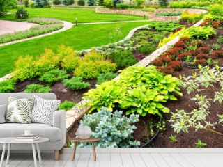 Landscape design of home garden. Beautiful landscaping of backyard or yard of residential house.