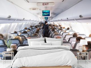 Inside view on passenger and cabin crew people on an airline airplane during flight  vacation. Transportation tourism aviation concept