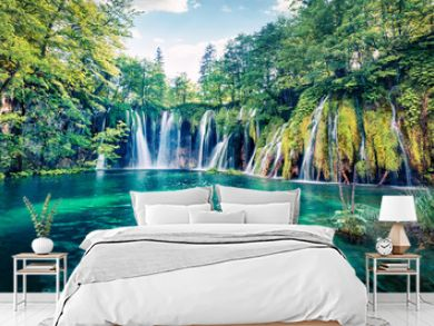Fresh morning view of pure water waterfall in Plitvice National Park. Picturesque spring scene of green forest with small lake, Croatia, Europe. Beauty of nature concept background.