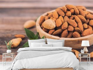 Fresh almonds in the wooden bowl