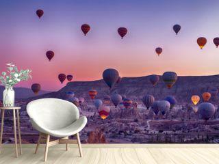 Hot Air balloons flying tour over Mountains landscape autumn sunrice Cappadocia, Goreme National Park, Turkey nature background.