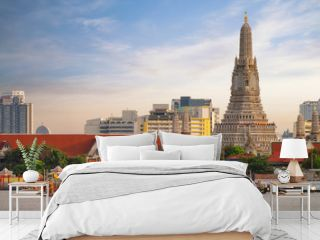 Traitional royal thai boat in river in Bangkok city with Wat arun temple background