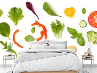 Creative layout made of tomato slice, onion, cucumber, basil leaves. Flat lay, top view. Food concept. Vegetables isolated on white background. Food ingredient pattern.