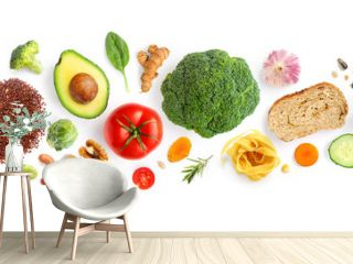 Creative layout made of walnuts, cashew, avocado, tomato, broccoli, bread, pasta, pepper, curcuma, rice and garlic on white background. Flat lay. Food concept. Macro concept.