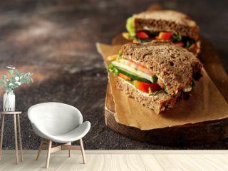 Prepared vegan sandwiches on dark rustic background