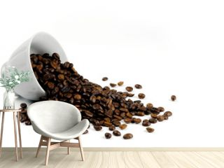 coffee beans spilling out of a cup isolated on white background.