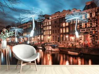 Wind driven propellers in white light above the Herengracht in the old town of Amsterdam