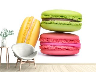 Yellow, pink and green macaron cookies isolated on white background