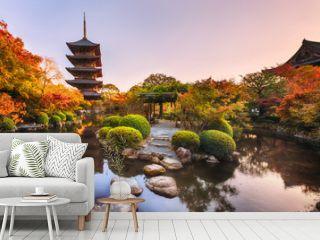Ancient wooden pagoda Toji temple in autumn garden, Kyoto, Japan.