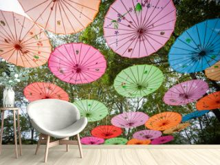 Chinese traditional multicolored umbrellas hanged on trees low angle view in Guilin, Guangxi province, China