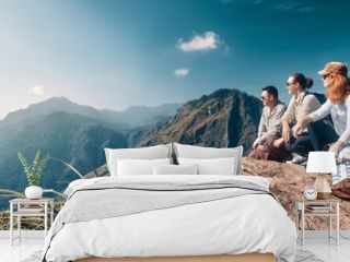 "The company of young travelers look at the beautiful mountain peak ""Adam's Peak"" on the island of Sri Lanka."