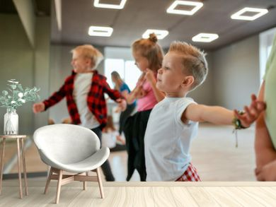 Modern dancers. Group of fashionable children learning a modern dance while having a choreography class. Dance studio