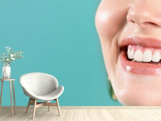 Laughing woman mouth with big teeth on a blue background. Healthy white teeth. Broad smile. Oral care.