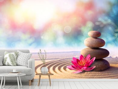 Lotus Flower With Spa Stones In Rock Garden