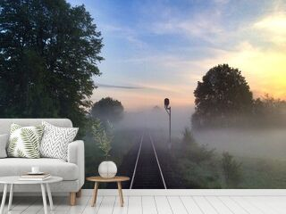 High Angle View Of Railroad Tracks Amidst Field In Foggy Weather