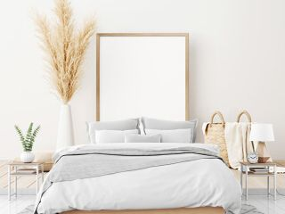 Vertical frame mockup standing on wooden floor in living room interior with dried pampas grass, woven basket, blanket and pillow with tassels on white wall background. 3d rendering, 3d illustration