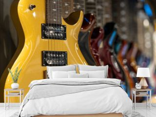 Row of electric guitars different color in a music instruments shop
