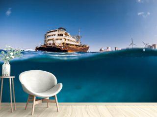 Old wreck ship in blue ocean in Arrecife, Lanzarote