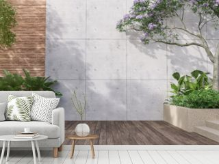 Empty exterior concrete wall with tropical style garden 3d render,decorate with tropical style tree ,sunlight on the wall