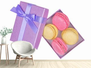 Purple box with different tasty macarons isolated on white background. Top view