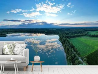 Aerial panorama view of a beautiful and dramatic sunset over a forest lake reflected in the water, landscape drone shot. Blakheide, Beerse, Belgium. High quality photo