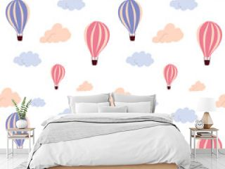 Seamless pattern with flying hot air balloon and colorful clouds, on a white background. Vector endless texture for travel design.