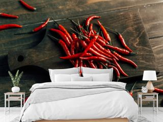 Chili peppers on a dark wooden board