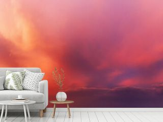 Dramatic sky background with orange and purple clouds at sunset.