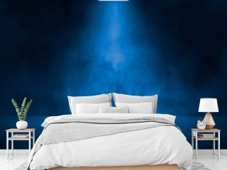 Empty dark blue abstract cement wall and studio room with smoke float up the interior texture for display products wall background