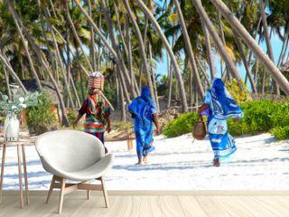 Zanzibar wimen on sandy beach